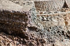 Collapse of soil with a piece of asphalt on the side royalty free stock photo