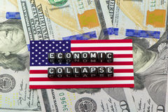 The collapse of the US financial system. On dollars background Royalty Free Stock Image