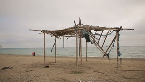 Collapsed awning of bamboo on an abandoned beach. Not the season, ecology concept stock footage