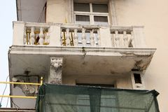 Collapsed balcony. Of an old apartment house in the stage of repair and reconstruction Stock Photography