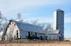 A Collapsed Barn. This is a Winter picture of a collapsed barn located in Johnson County, Iowa.  It appears that the under pinnings gave way.  This picture was Stock Photos