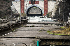 A collapsed bridge and tunnel flooded with water Stock Photos