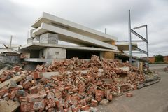 Collapsed building in disaster zone. A collapsed building in disaster area Royalty Free Stock Images