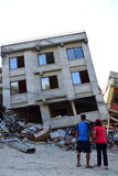 Collapsed building after earthquake disaster Stock Images