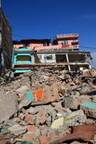 Collapsed building after earthquake disaster Stock Photos