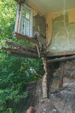 A collapsed floor in the room of a private house, fragment of the wall and window. Destruction of the foundation by groundwater. Ruined damaged building stock images