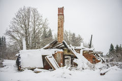 Collapsed house in snow Royalty Free Stock Photography