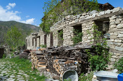 Collapsed house walls. Collapsed old rustic stone walls Stock Photos