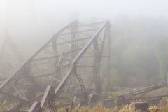 Collapsed Metal Framing from Bridge. Mangled metal framework from the Kinzua bridge. The kinzua bridge used to be the tallest and longest railroad structure for Stock Photo