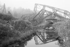 Collapsed Metal Framing from Bridge over Creek. Mangled metal framework from the Kinzua bridge. The kinzua bridge used to be the tallest and longest railroad Stock Photography