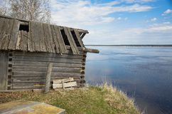 Old wooden house by the river stock images