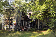 Collapsed old wooden house. An abandoned and collapsed old wooden house Stock Image