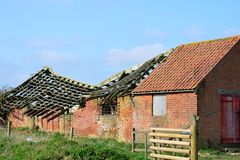 Collapsed roof and barn Stock Image