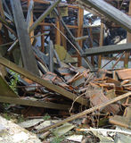 Collapsed roof showing wood glass,and stone rubble Stock Photography