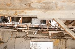 Collapsed roof of the total damaged domestic house indoor from natural disaster or catastrophe.  stock images