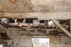 Collapsed roof of the total damaged domestic house indoor from natural disaster or catastrophe.  Royalty Free Stock Images