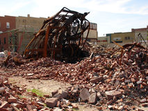 Collapsed urban building. Rubble and burnt shell of modern urban building Stock Photos