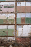 Collapsed wall. One wall of the old brick house has collapsed. Rooms, painting and plaster were bared. Abstract background Stock Photography