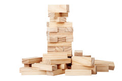 Collapsed wooden blocks tower. Isolated on white background stock photo