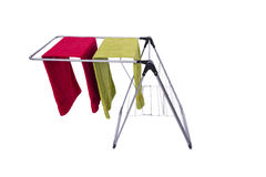The collapsible clotheshorse isolated on the white background. Collapsible clotheshorse isolated on the white background Stock Photo