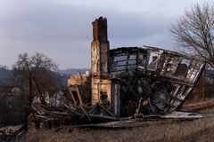 Collapsing, Abandoned House on Barren Street at Sunset Stock Image