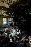 Collapsing Floor with Fireplaces - Abandoned House. An open door leads to a room with a collapsing floor and ceiling with fireplaces visible in an abandoned stock photography