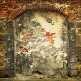 Collapsing stone wall of an old house Royalty Free Stock Image