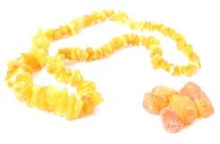 Collar anaranjado, brillante para la mujer con el ámbar crudo Foto de archivo libre de regalías