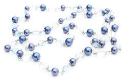 Collar azul, brillante para la mujer en el fondo blanco Fotografía de archivo libre de regalías