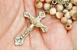 Collar with crucifix. And pearls Stock Image