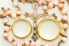 Crucifix and wedding rings. Collar with crucifix and wedding rings Stock Photo