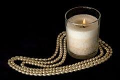 Collar de la perla con la vela Foto de archivo libre de regalías
