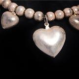 Collar con un corazón de plata Foto de archivo