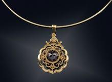 Collar de oro con en negro Imágenes de archivo libres de regalías