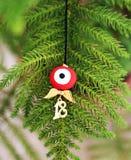 Collar del mal de ojo con el colgante 2018 Imagen de archivo libre de regalías
