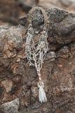 Collar hecho a mano del boho que miente en piedras Fotografía de archivo libre de regalías