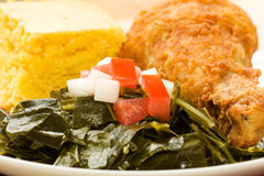 Collard Greens. Fried Chicken served with collard greens and cornbread stock images