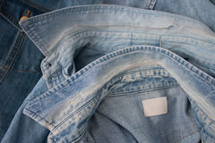 Collars of denim shirts. Closeup of two vintage denim shirts from above in studio shot Royalty Free Stock Photos