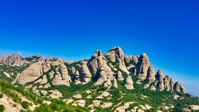 Collbato , catalonia, spain. Collbato, catalonia Spain mountain range containing Monserrat monastery of religious significance royalty free stock image