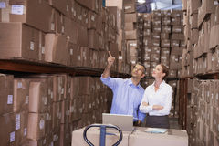 Colleague with laptop at warehouse Stock Photography