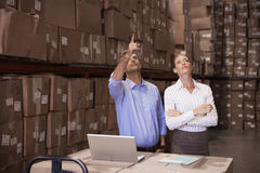 Colleague with laptop at warehouse Stock Photos