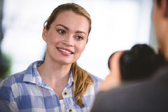 Colleague posing for photographer at creative office Stock Images