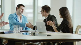 Colleagues applauding the boss. During a meeting in the meeting room stock footage