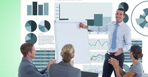 Colleagues applauding while businessman giving presentation against graphs Stock Photo