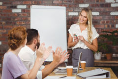 Colleagues applauding businesswoman Stock Image