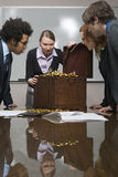 Colleagues around a treasure chest Royalty Free Stock Photo