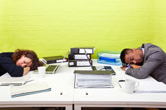 Colleagues asleep at their respective desk Royalty Free Stock Image