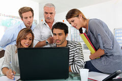 Colleagues behind a laptop Royalty Free Stock Photo
