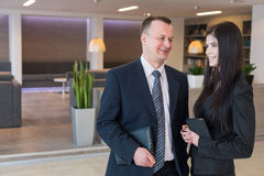 Colleagues in business suits talking at the office royalty free stock photography