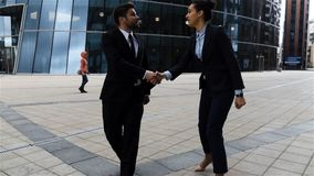 Colleagues, businessmen and businesswomen doing a handshake. stock footage